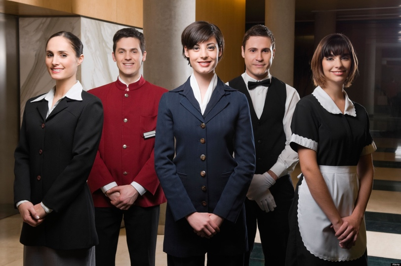 B62PW9 Hotel staff standing together and smiling